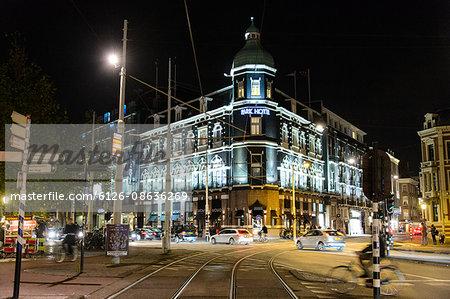 Netherlands, Amsterdam, Corner view of illuminated Park Hotel