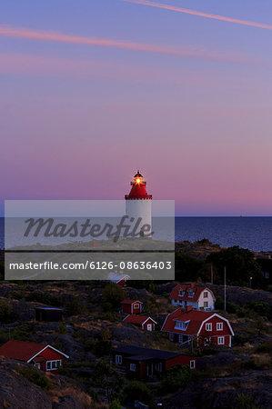 Sweden, Sodermanland, Stockholm archipelago, Oja, Landsort, Illuminated lighthouse on village hill