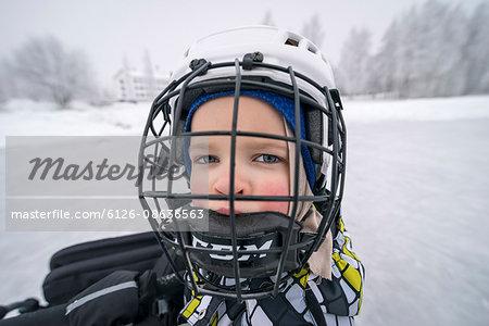 Finland, Pohjois-Pohjanmaa, Oulu, Portrait of boy (6-7) in ice hockey helmet