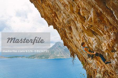 Greece, Dodecanese, Kalymnos, Rock climber on steep cliff