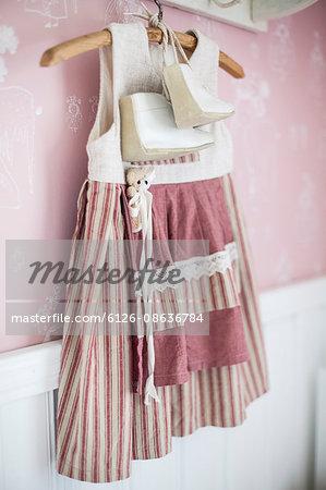 Finland, Dress of little girl on coathanger