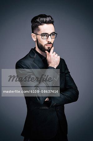 Portrait of a young businessman pensive