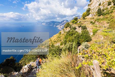 Hikers on the famous trail of Sentiero degli Dei (Path of the Gods) above the Amalfi Coast, Italy