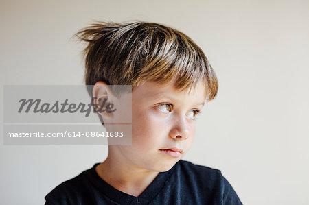 Studio portrait of boy looking away