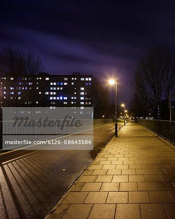 Sweden, Skane, Malmo, Rosengard, Illuminated footbridge at night