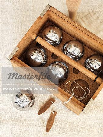 Sweden, Vastergotland, Petanque set in wooden container