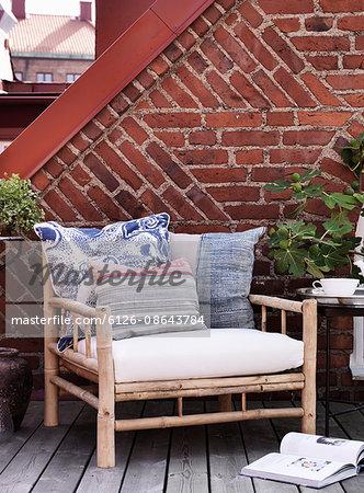 Sweden, Vastergotland, Armchair with pillows
