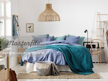 Sweden, Vastergotland, Bedroom with large bed