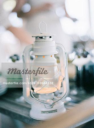 Sweden, White lantern burning on table