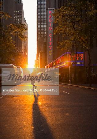 USA, New York, Street with pedestrians at sunset