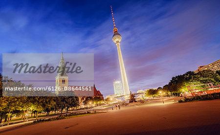 Germany, Berlin, Fernsehturm Berlin illuminated against dusk sky