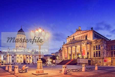 Germany, Berlin, Gendarmenmarkt, Illuminated buildings and street light at dusk