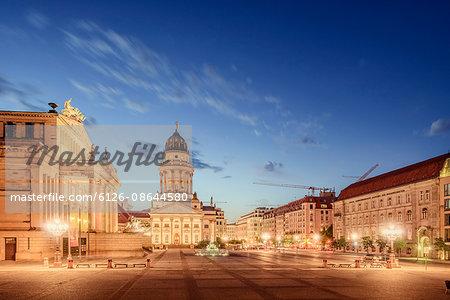 Germany, Berlin, Gendarmenmarkt, Illuminated town square at dusk