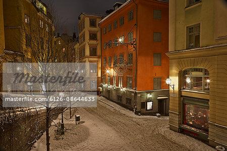 Sweden, Stockholm, Gamla Stan, Osterlanggatan, Illuminated city street in winter
