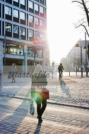 Finland, Helsinki, Esplanadi, Woman walking across street