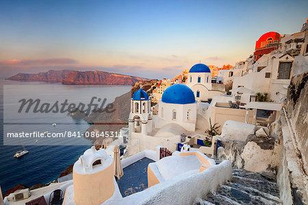 White houses and blue domes of the churches dominate the Aegean Sea, Oia, Santorini, Cyclades, Greek Islands, Greece, Europe