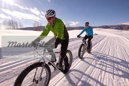 Couple snow biking in Colorado