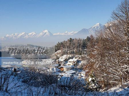 View of Austrian village in snow alps