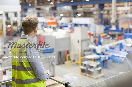Supervisor on platform over steel factory