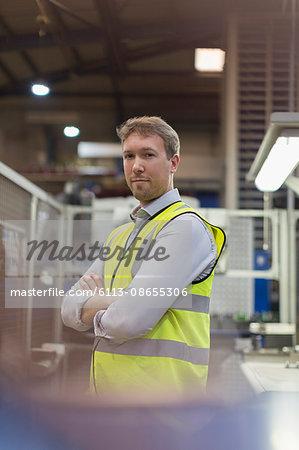 Portrait confident supervisor in steel plant