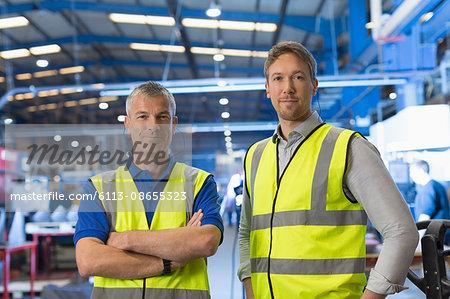 Portrait confident supervisors in steel factory