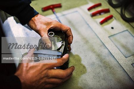 Worker assembling parts in steel factory