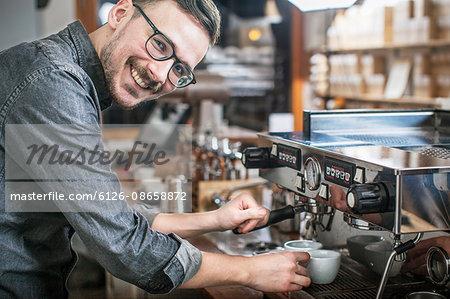 Sweden, Smiling barista making coffee