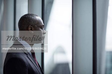 Serious pensive businessman looking away