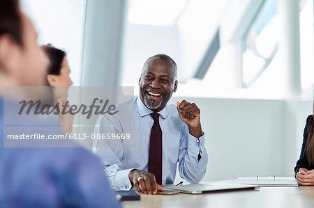 Laughing businessman enjoying meeting