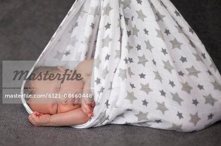 Close-up of cute newborn baby girl sleeping in hammock, Fürstenfeldbruck, Bavaria, Germany