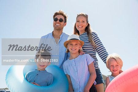 Portrait of a happy family enjoying on the beach
