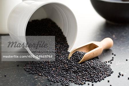 Beluga. Black lentil on kitchen table.