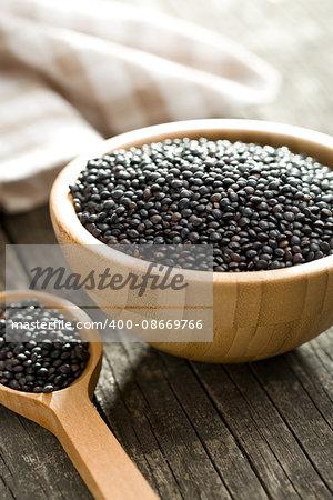 Beluga. Black lentil in wooden bowl.