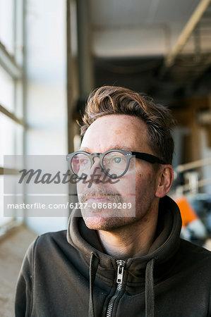 Thoughtful carpenter in workshop