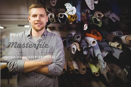 Portrait of cobbler standing in workshop
