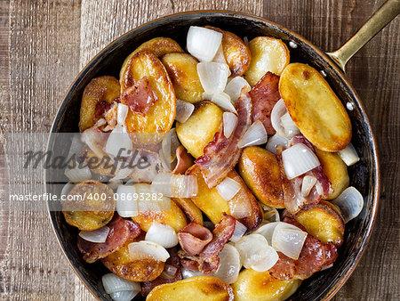 close up of rustic german home fries bratkartoffeln