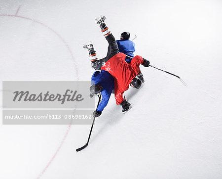 Hockey players colliding on ice