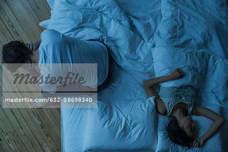Man unable to sleep while wife sleeps comfortably unaware