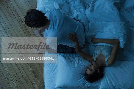 Woman reassuring husband
