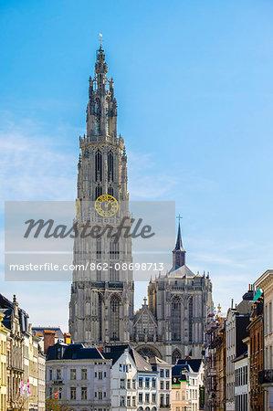 Belgium, Flanders, Antwerp (Antwerpen). Tower of Onze-Lieve-Vrouwekathedraal (Cathedral of Our Lady) from Suikerrui.