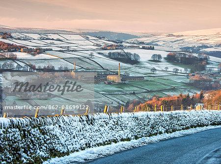England, Calderdale. Luddenden village and mills in winter.