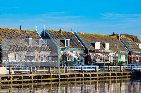 Netherlands, North Holland, Marken. Wooden buildings along the harbor in Havenbuurt.