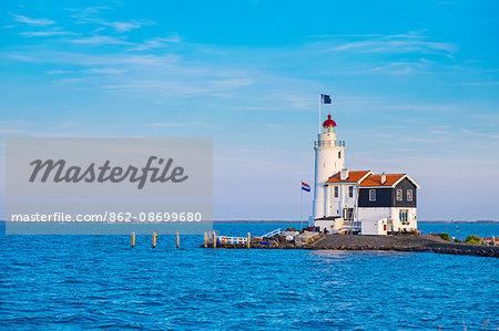 Netherlands, North Holland, Marken. Het Paard van Marken (English: Horse of Marken) lighthouse on the IJsselmeer.