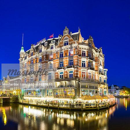 Netherlands, North Holland, Amsterdam. Hotel De l'Europe on the Amstel River.