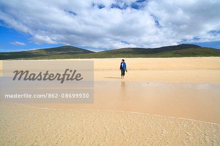 Scotland, Isle of Harris. A lady on Scarista Beach on the Isle of Harris. MR.