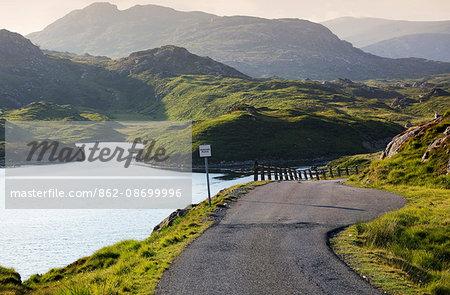 Scotland, Western Isles, Isle of Harris. A road on Harris in evening light.