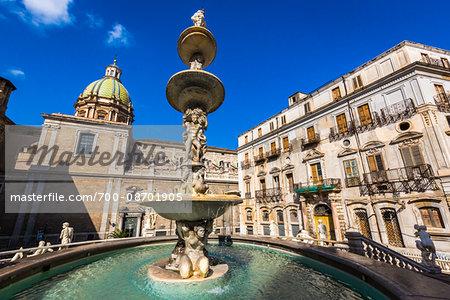 Buildings surrounding the Pretoria Fountain with central statues in Piazza Pretoria (Pretoria Square) in the historic center of Palermo in Sicily, Italy