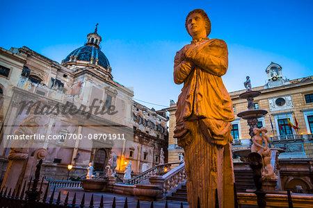 Close-up of statue illuminated at dusk at the Pretoria Fountain in Piazza Pretoria (Pretoria Square) in the historic center of Palermo in Sicily, Italy
