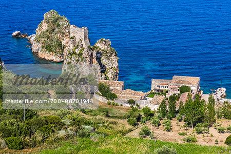 Elevated view of the coastline with the historic Tonnara di Scopello (Old Tuna Factory) estate in Scopello in the Province of Trapani in Sicily, Italy