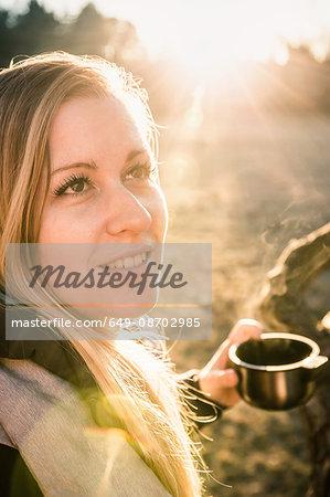 Woman having coffee on sunny day